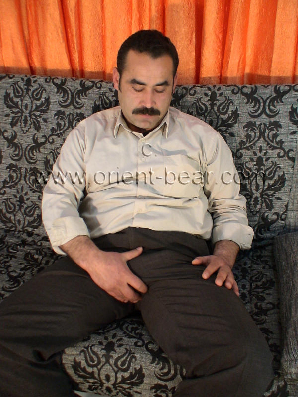 A naked haired turkish bear with an always rock hard cock and a erotic face in a turkish gay video